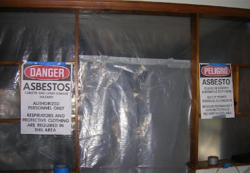 Asbestos abatement area with warning signs