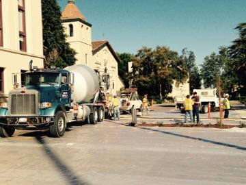 Contractor pouring concrete in front of the Mission Church